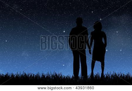 Woman and man under the night sky