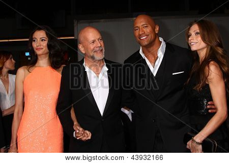 LOS ANGELES - MAR 28:  Emma Heming, Bruce Willis, Dwayne Johnson, Lauren Hashian arrives at the