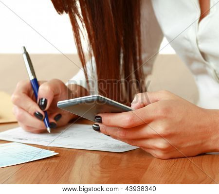 A woman with documents  at the desk - on white background