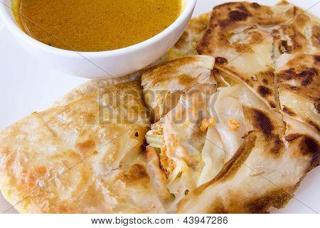 Indian Roti Prata With Curry Sauce Closeup