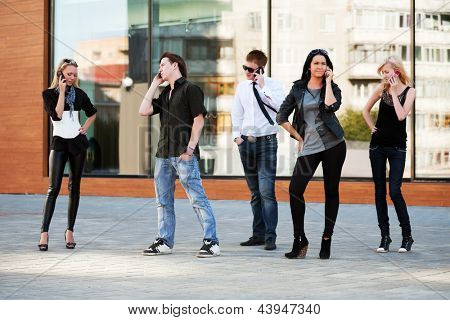 Group of young people calling on the mobile phones