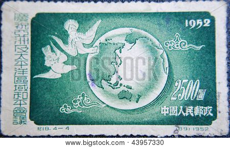 CHINA - CIRCA 1952: stamp printed by China at 1952 shows  Globe with two flying doves