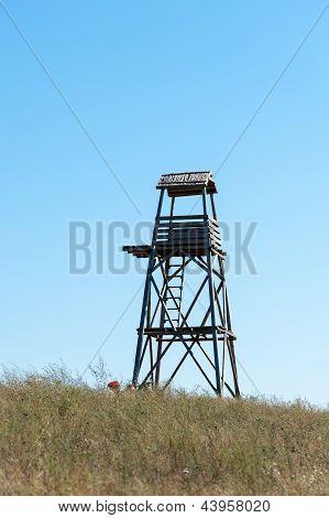 Wooden Watchtower In Grass