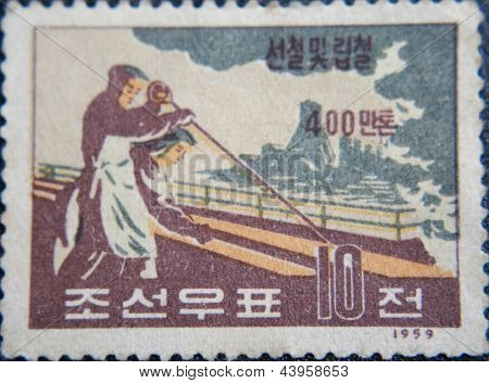 CHINA - CIRCA 1959: stamp printed by China at 1959 shows  two chinese workers in metallurgy
