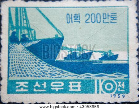 CHINA - CIRCA 1959: stamp printed by China at 1959 shows  3 ships with fishermens