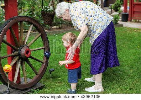 Great-grandmother With Little Baby Boy