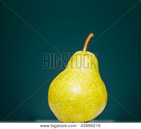 Green Pear On Green Background