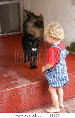 Toddler And Black Cat
