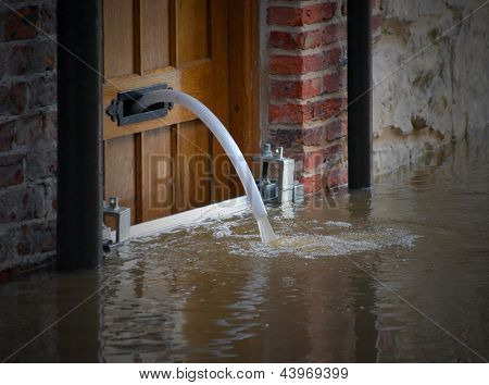 River water being pumped out of flooded house
