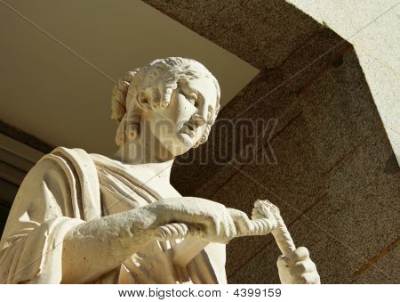 Statue Of A Woman Made Of White Stone