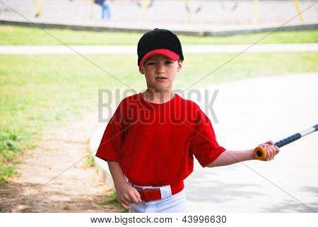 Little Baseball Player Holding Bat