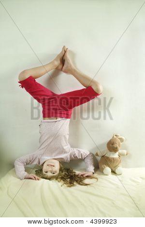 Little Cute Girl Standing On Head