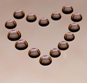 Water drops in the form of heart on a celebratory background poster