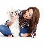 beautiful girl with perfect skin and long wavy hair with a fluffy white dog on a white background poster