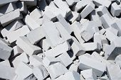 Chaotic pile of the white bricks background. poster