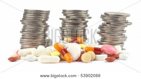Rolls of Euro Coins and colorful spilled pills