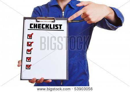 Construction worker holding clipboard with checklist and pointing with finger to it