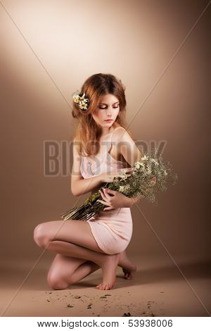 Sentimental Auburn Barefoot Woman Relaxing With Wildflowers