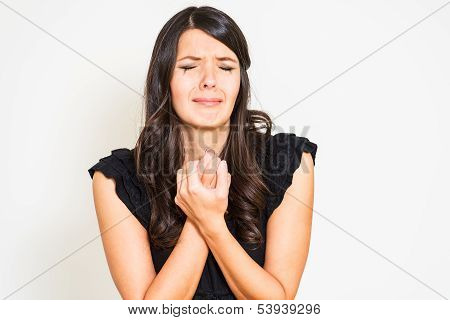 Tearful Distressed Woman Wringing Her Hands And Holding A Ring