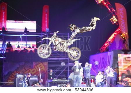 MOSCOW - MAR 02: Jump on a motorcycle with acrobatic elements on the festival extreme sports Breakthrough 2013 in the arena of the Sports Complex, on March 02, 2013 in Moscow, Russia.