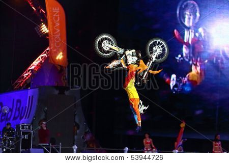 MOSCOW - MAR 02: Somersault on a motorcycle with acrobatic stunts on the festival extreme sports Breakthrough 2013, on March 02, 2013 in Moscow, Russia.