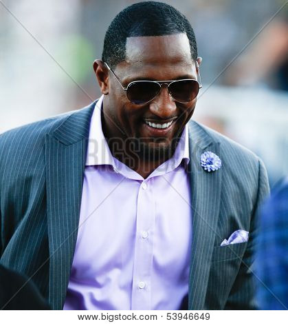 CANTON, OH-AUG 3: Former Baltimore Ravens linebacker Ray Lewis (R) walks off the field during the NFL Class of 2013 Enshrinement Ceremony at Fawcett Stadium on August 3, 2013 in Canton, Ohio.