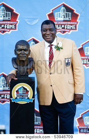 CANTON, OH-AUG 3: Former Green Bay Packers linebacker Dave Robinson poses with his bust during the NFL Class of 2013 Enshrinement Ceremony at Fawcett Stadium on August 3, 2013 in Canton, Ohio.