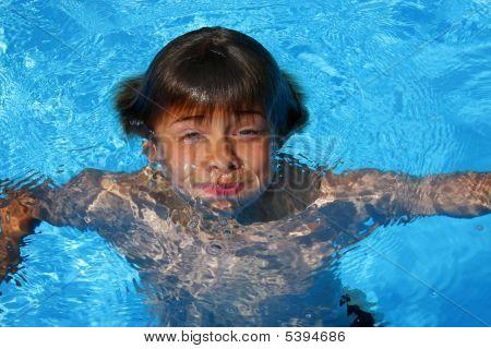 Boy Having Fun In Swimming Pool