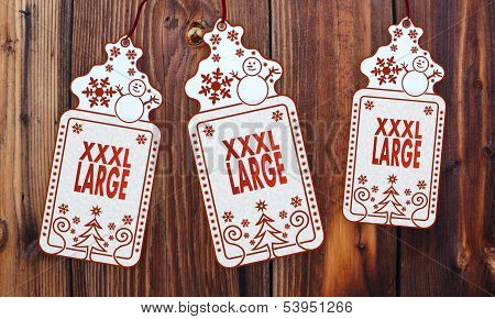 Three Christmas Cards With Xl Sign