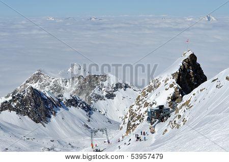 Skiers skiing on ski slope in a ski resort. Kitzsteinhorn, Austria