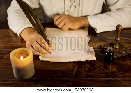Man Writing On A Parchment