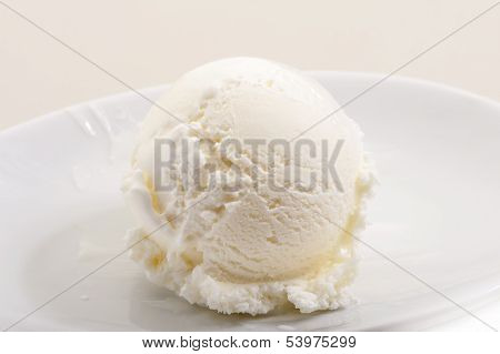 Ice cream scoop on white plate