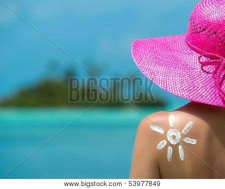 Woman with sun-shaped sun cream