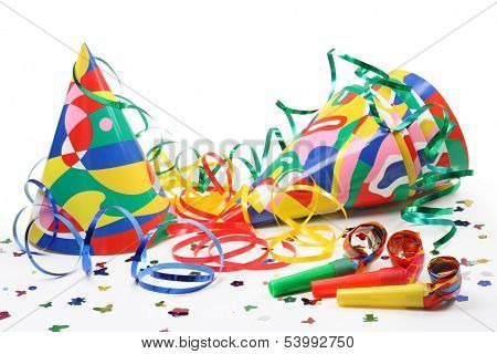 Party hats, paper streamer and  whistles isolated on white background