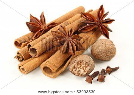 Cinnamon, anise, nutmeg, and cloves  isolated on white background