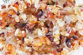 Pieces of natural carnelian closeup as a background poster