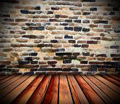 weathered interior architectural backdrop with wood floor and old brick wall poster