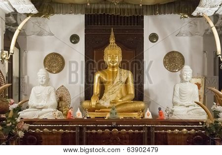 KANDY, SRI LANKA - FEBRUARY 26, 2014: Buddha statues inside the Temple of the Tooth. The Sacred Tooth Relic of the Buddha attracts thousands of pilgrims and tourists to the sacred city of Kandy.