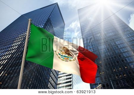 Mexico national flag against low angle view of skyscrapers poster