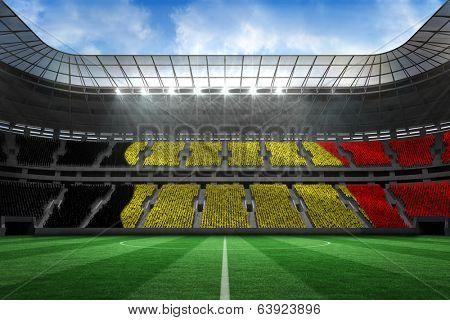 Belgium flag against large football stadium poster