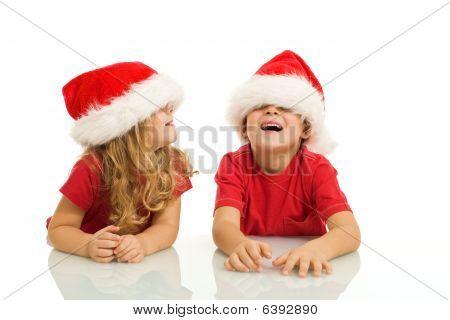 Kids Having Fun With Christmas Hats