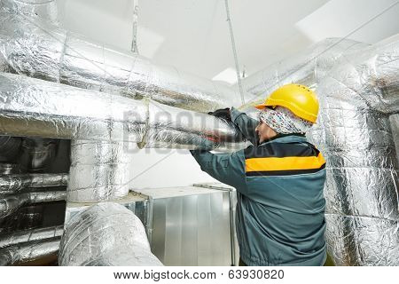 Thermal insulation. Female insulation worker isolating industrial pipe with glass wool and foil poster