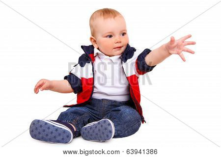 Little Boy Sitting Isolated On A White Background