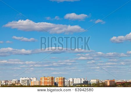 White Clouds In Blue Sky Over Urban District