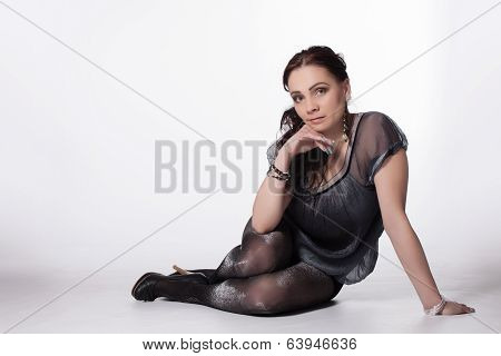 Young Long-haired Woman In Transparent Babydoll, Glittering Stockings, And High Heels