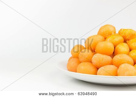 Gold Egg Yolks Drops Isolated On White Background.