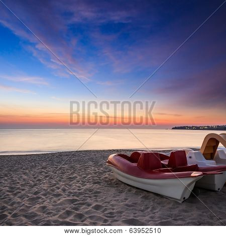 Calm Sea Beach With Boats