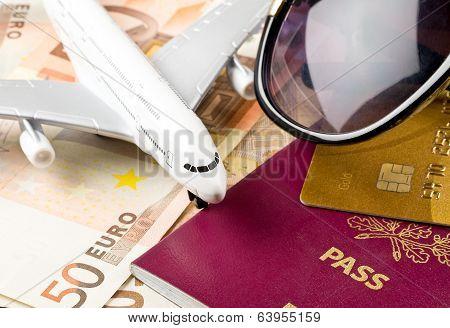 Money, Documents And Sunglasses