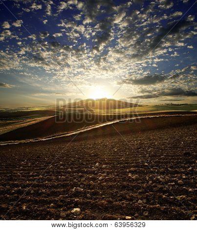 sunset on plowed land