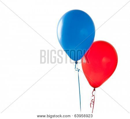 Red and blue balloons on a white background with copy space